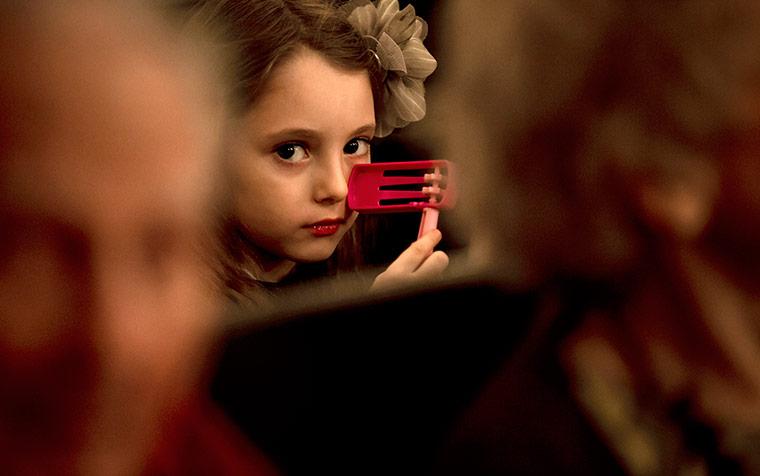 Sara holds a Purim noisemaker