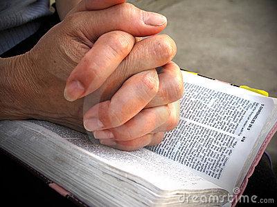 praying-on-bible
