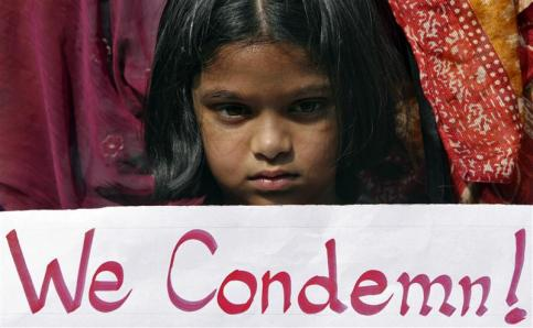 Girl holds a placard as she takes part in a protest rally in Hyderabad